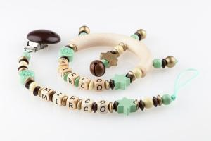nuggikette-mit-greifling-geschenkset-sonne-und-sterne-mint-gold